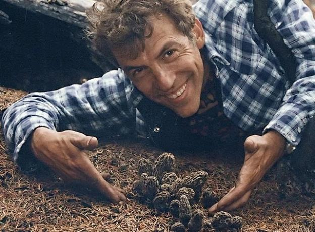 Fungus Fair founder David Arora photographed around 1990 with some wild morels. Creative Commons photo.