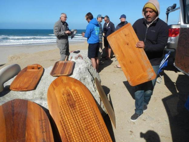 Brian Himilan of Longship Designs holding the only board he needs to travel the world.