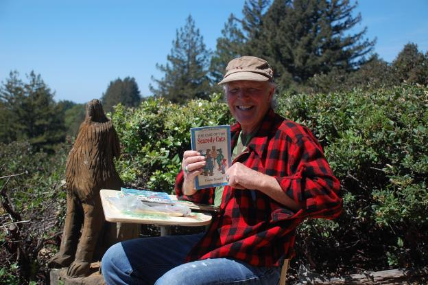 Forest caretaker Jeff Helmer holds up one of the treasures from the park's many rest stops. Photo courtesy Land Trust.