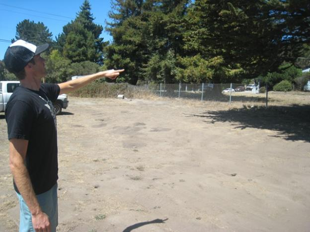 Another Bike Shop owner Chris Wagner-Jauregg points out future features of the Westside pump track. Photo by Andrew Juiliano.