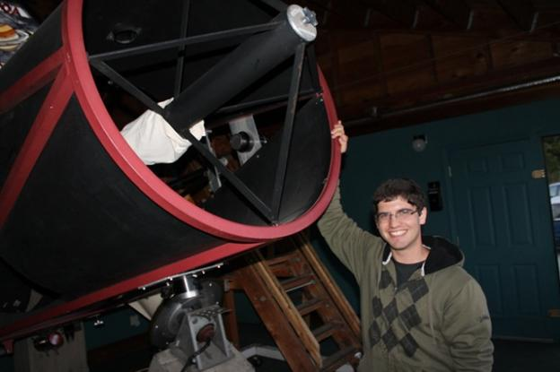 Edward Levin demonstrates the 30-inch Challenger telescope.