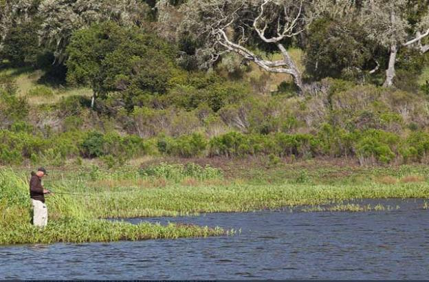 An angler on Mudhen Lake in the Fort Ord National Monument.
