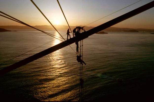 """Protesters attempted to unfurl a banner over Golden Gate Bridge in 1990. Greg King said, """"This action was the unofficial kick-off to Redwood Summer, an intense series of protest activities. Federal officials meanwhile were orchestrating arrests of our support group, who were standing in legal areas on the ground, breaking no laws. They somehow knew who the group members were."""" King was also arrested. Photo courtesy Greg King."""