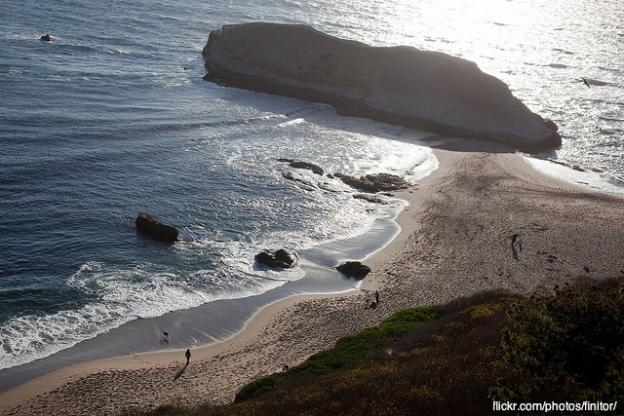 Looking down on long Greyhound Rock from the Highway 1 bluffs. Photo by Finitor on flickr.