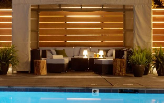 The cozy poolside cabanas at Hotel Paradox come with comfy furnishings, full service from Solaire and complimentary oversize towels.