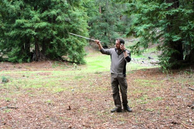 Wildlife biologist Paul Houghtaling listens for faint clicks signaling that a puma is nearby.  Brendan Bane photo.