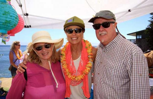 KPIG's Girl in the Curl, Zeuf Hesson (center) with Tim and Sheryl Loomis.