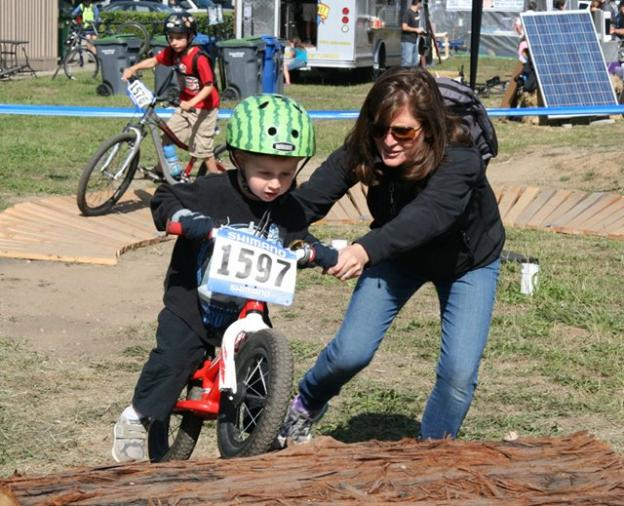 The 2014 Santa Cruz Mountain Bike Festival will attract many parents and kids practicing their skills like this pair pictured here in 2013.