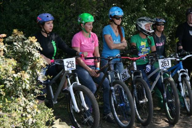 Women dirt jumpers prepare to compete at the debut of the Sugar Showdown, presented by Sweetlines Mountain Bike Coaching in 2013 at the Santa Cruz Mountain Bike Festival.