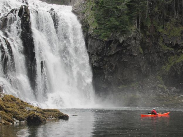 Sea kayaking up to the largest waterfall in the Prince William Sound.