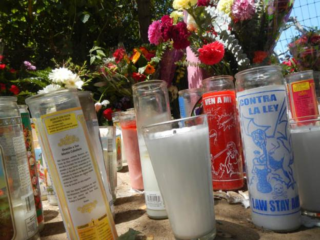 Votive candles beseech the Virgin of Pinto Lake.