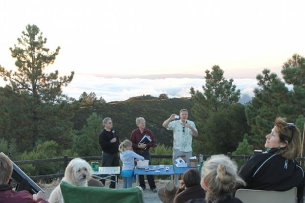 Members of the Fremont Peak Observatory Association raffle telescopes and books to an eager crowd.