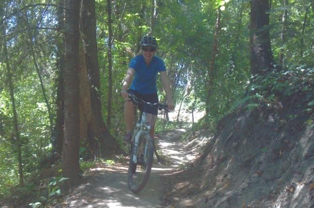 Mountain biker on Emma McCrary Trail in Pogonip in Santa Cruz, California. Hilltromper photo.