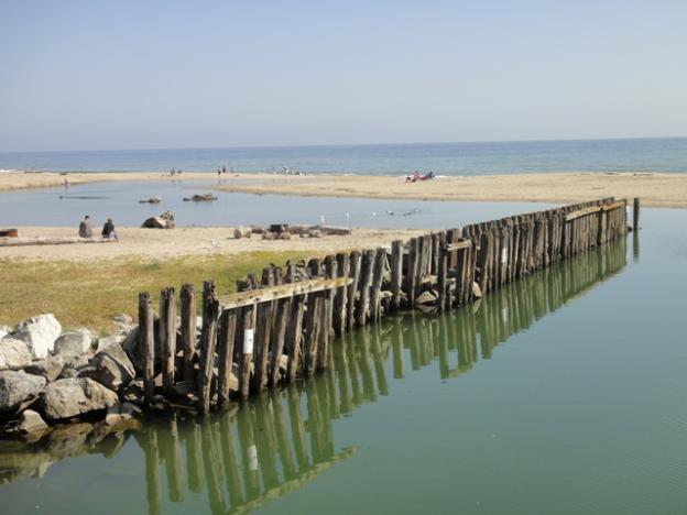 Aptos Creek meets the Pacific Ocean at Rio Del Mar, sometimes creating a summertime lagoon. Photo by Garrett McAuliffe.
