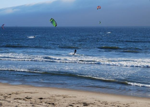 Strong northwesterly winds make Waddell Beach a major kitesurfing destination. (It glasses off, too, so surfers can have a shot.) Photo by Joe Gomez.