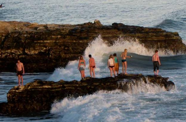 Local officials advise staying away from the rocks because of frequently rough surf.