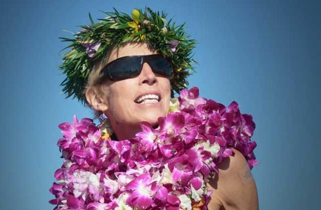 """Robin """"Zeuf"""" Janiszeufski Hesson, KPIG's longtime """"Girl in the Curl,"""" hosted a paddle-out life celebration at Pleasure Point."""