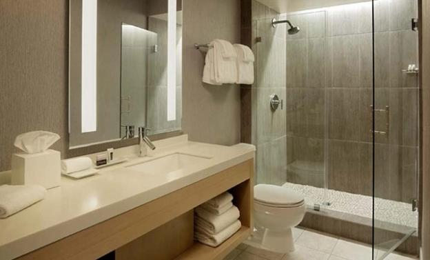 Contemporary styling carries through to renovated bathrooms.