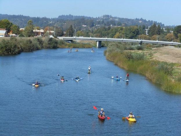 A flotilla of funsters on the Coastal Watershed Council's San Lorenzo River Paddle. Photo by Melissa Foley.