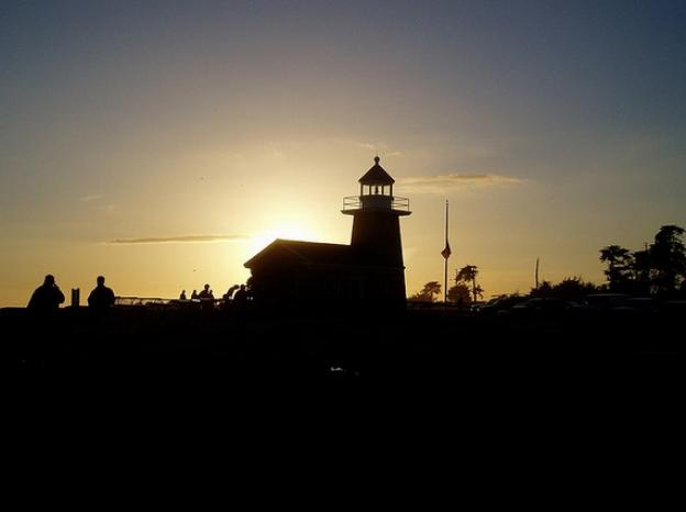The Lighthouse soaks in it's last rays of the day. Photo by Jun on Flickr.