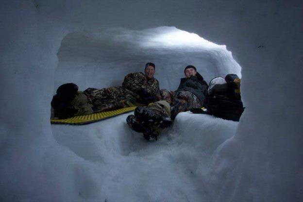 Winter adventurers learn to build cozy (and warm!) snow caves.