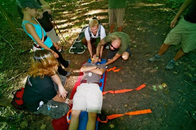 Wilderness first aid instructor Mike Stahlman demonstrates how to stabilize a patient's upper body. Photo courtesy Mike Stahlman.