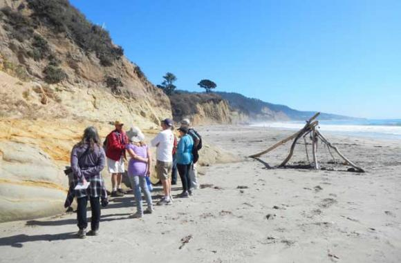 Docent Jeff Phillips leads a Coastal Geology Tour at Año Nuevo State Park. To the south lies El Jarro Point, nearly the site of the largest nuclear power plant in California.