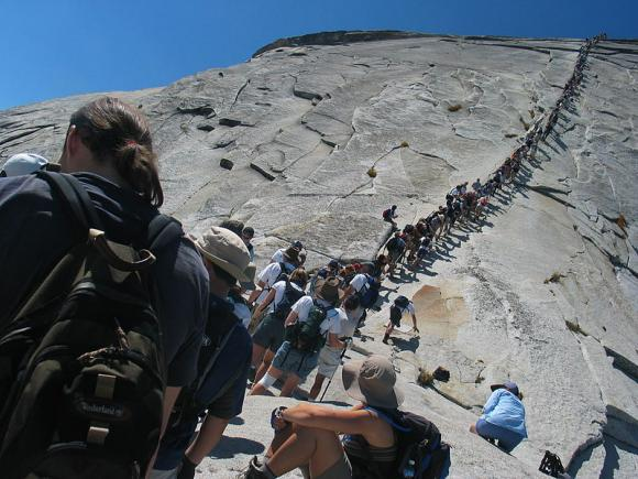 Hikers on the Half Dome cables at Yosemite. Photo by Daniel Schwen on Creative Commons.
