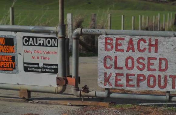 "The gate to Martins Beach is still locked, despite last week's court order to open it. Image from ""Martin's 5: Battle for the Beach,' by The Inertia. (See video below.)"