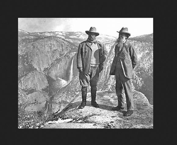 President Roosevelt and John Muir at Glacier Point in 1903. Their impromptu three-day camping trip led to the federal government taking back Yosemite Valley and Mariposa Grove from the state of California. National Park Service Historic Photo.