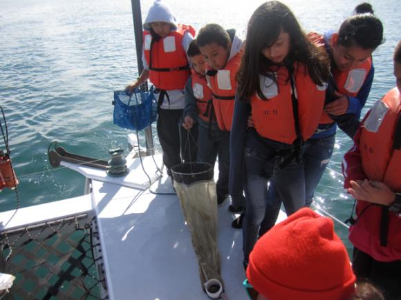 Fifth graders from Watsonville's Ann Soldo Elementary School help O'Neill Sea Odyssey instructor Celia Lara collect a seawater sample for examination. All photos by Hilltromper.