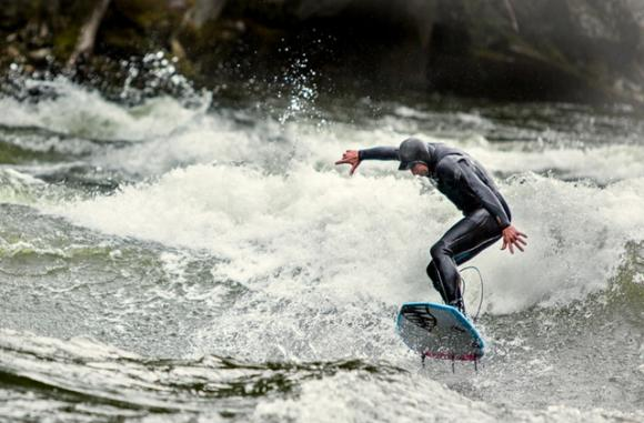 "River surfer Kevin Benhart Brown says ""Missoula is turning into a surf town."" Photo by Paolo Marchesi, copyright Outside Magazine."