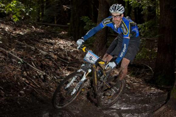 Santa Cruz-based pro racer Scott Chapin cruises through a turn in the inaugural Santa Cruz Super Enduro last October.