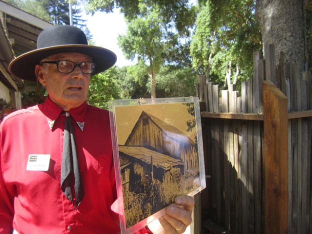 Charlie Kieffer, Friends of Santa Cruz State Parks board member and descendant of the Castro family, with a photo of the Adobe from the 1930s, when it was being used as a barn.