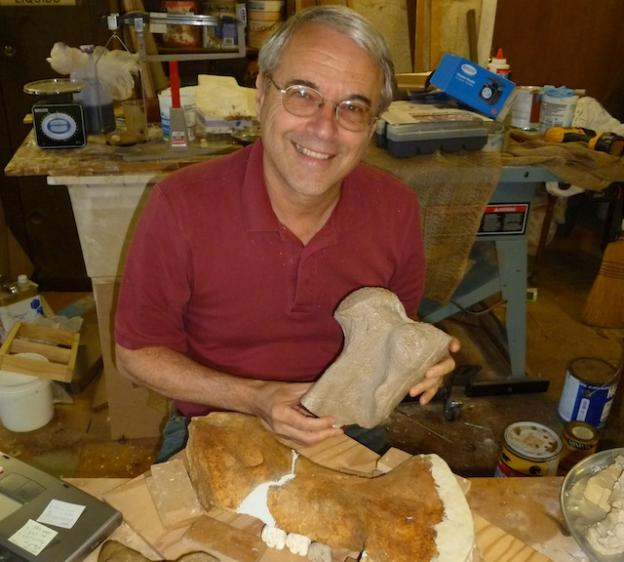 Frank Perry holding a cast of a fossil sea cow bone from Scotts Valley. Photo by Jill Perry.