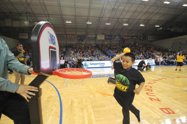 Anthony Carreno, 8,  shows some style at a Santa Cruz Warriors Kids Slam Dunk Contest last night. Chip Scheuer photo.