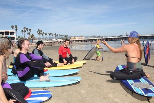 Before the lesson instructor Nina Ke'alohi Dodge gives some pointers on the beach. (Chip Scheuer)