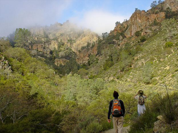Two hikers look up Condor Gulch Trail at Pinnacles National Park. Photo credit: Miguel Vieira/Creative Commons.