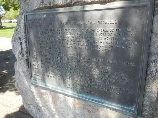 """A plaque commemorates the Portola Expedition's """"discovery"""" of redwoods at Pinto Lake."""