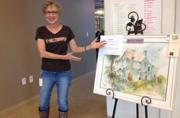 You can win the lovely painting that Renee Winter, local attorney and happy Hilltromper, is pointing to!