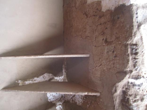In renovating the cocina, workers were careful not to damage the original corner shelving.