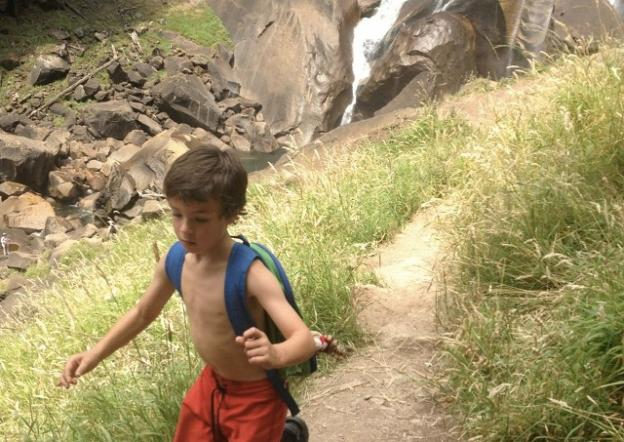 Yosemite Valley provides more than enough space for a party of four boys to run around ...