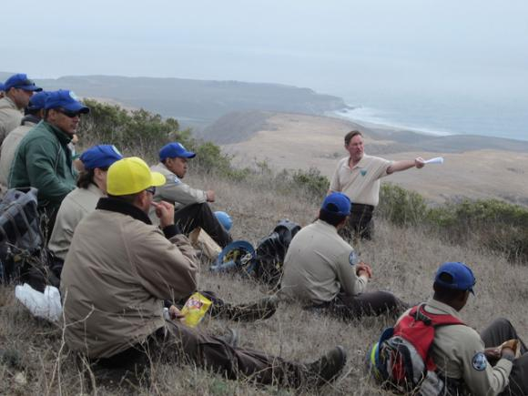 Rick Cooper of BLM welcomes a CCC crew made up of young veterans to a trail-building event at Coast Dairies on Saturday, Oct. 3. Photo courtesy Conservation Lands Foundation