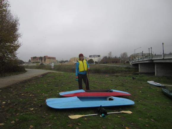 """Becca Moeller with her two homemade kayaks, the """"Robbie Lynn"""" and the """"Dos Lados."""" Hilltromper photo."""
