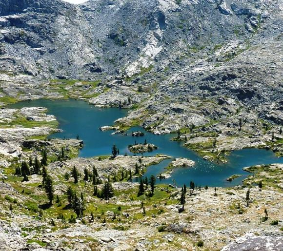 Desolation Wilderness, just south of Lake Tahoe in the Sierra Nevada, draws throngs to picturesque spots like Island Lake. Photo by Brooke Wright.