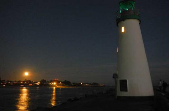 The moon rises over the East Side on Nov. 6, 2014, as seen from the Santa Cruz harbormouth. Ryan Masters photo.