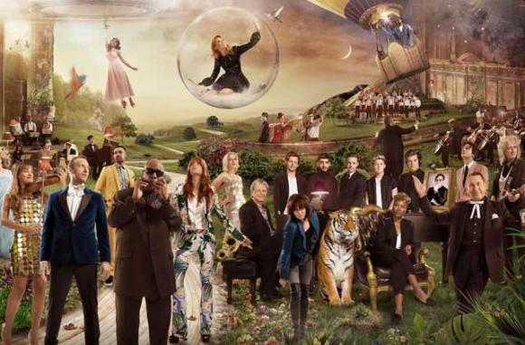 Beach Boy Brian Wilson (at right in foreground) is joined by dozens of mostly-British sngers in this surreal video (below).