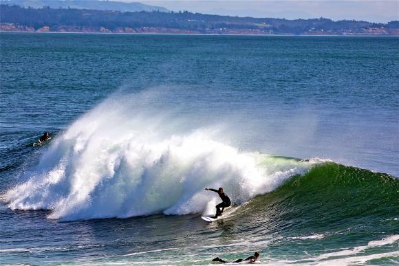 Steamer Lane is almost always breaking — and packed with protective locals. Photo by Chip Scheuer.