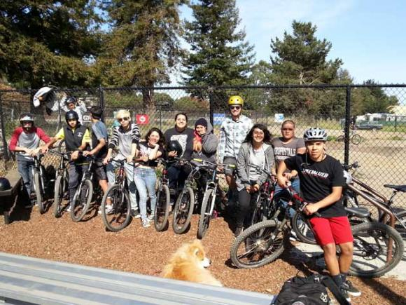 A bunch of smiling PVHS kids at the pump track. There is no pump track in South County. Not yet. Dave Robinson photo.