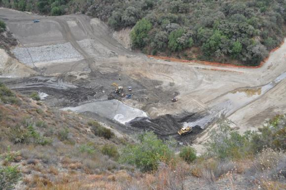 Heavy machinery rearranges the confluence of the Carmel River and San Clemente Creek on Aug. 7, 2015.